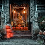 a monk enters a temple at Chiang Mai Thailand