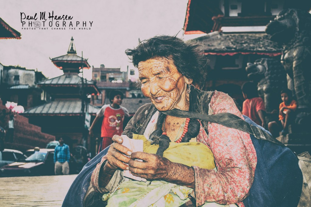A street women in Durbar square counts some cash we had in our pocket. We gave her more that that - a warm hug that said you are loved and valuable.